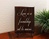 Love is a friendship set to music. Decorative Carved Wood Sign Quote, Faux Cherry